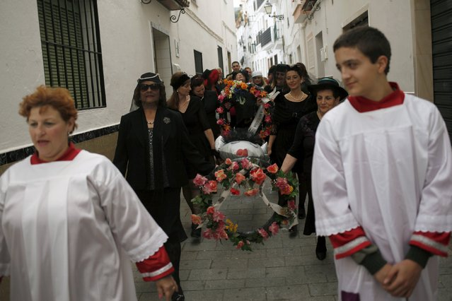 """Women dressed up as widows re-enact the traditional burial of the sardine during """"El Dia de los Polvos"""" (Powder Day) festival in Tolox, near Malaga, southern Spain, February 9, 2016. (Photo by Jon Nazca/Reuters)"""