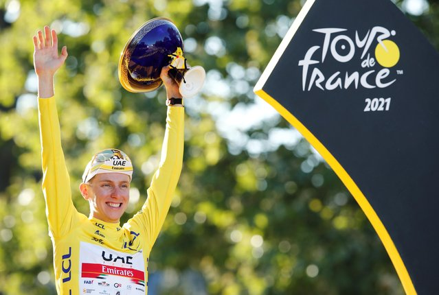 Winner Team UAE Emirates' Tadej Pogacar of Slovenia celebrates his overall leader yellow jersey on the podium at the end of the 21th and last stage of the 108th edition of the Tour de France cycling race, 108 km between Chatou and Paris Champs-Elysees, on July 18, 2021. (Photo by Benoit Tessier/Reuters)