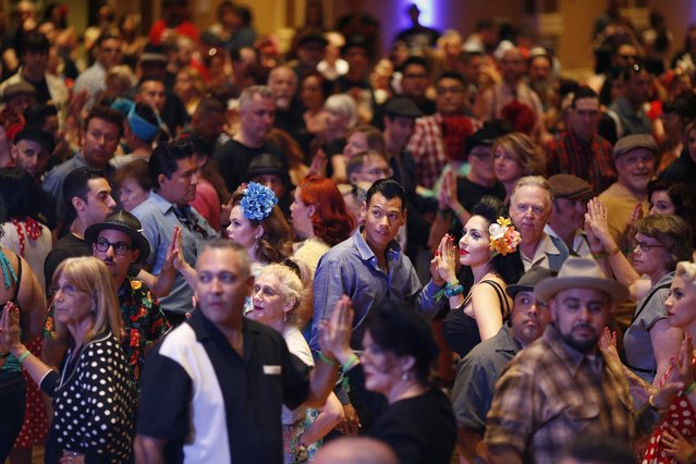 In this April 3, 2015, photo, people crowd the dance floor at a jive dance class during the Viva Las Vegas Rockabilly Weekend in Las Vegas. The event keeps alive dancing and other aspects of the 1950's rockabilly culture. (Photo by John Locher/AP Photo)