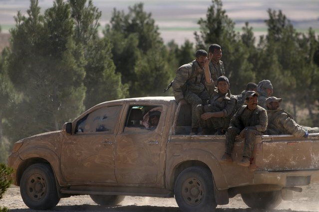 Democratic Forces of Syria fighters ride a pick-up truck near al-Shadadi town, Hasaka countryside Syria February 18, 2016. (Photo by Rodi Said/Reuters)