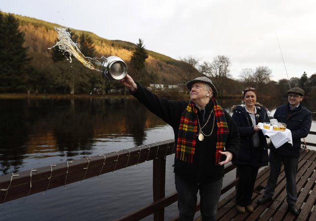 Provost Liz Grant blesses the river with whisky on the opening day of the salmon fishing season on the River Tay at Kenmore in Scotland, Britain January 16, 2017. (Photo by Russell Cheyne/Reuters)