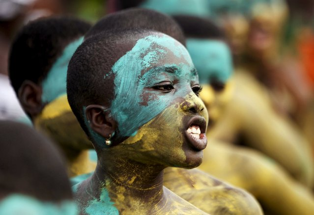 Youth with a painted face sings in a parade during the Popo (Mask) Carnival of Bonoua, in the east of Abidjan, April 18, 2015. (Photo by Luc Gnago/Reuters)