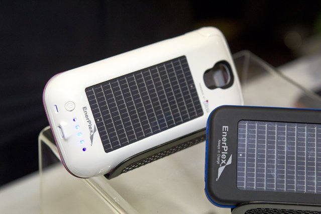 "Smartphone cases with solar photovoltaic cells by EnerPlex are displayed during ""CES Unveiled"", a media preview event to the annual Consumer Electronics Show (CES), in Las Vegas, Nevada, January 5, 2014. The cases retail for $89.99-$99.99 depending on the model. (Photo by Steve Marcus/Reuters)"