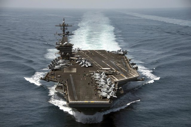 The aircraft carrier USS Theodore Roosevelt (CVN 71) operates in the Arabian Sea conducting maritime security operations in this U.S. Navy photo taken April 21, 2015. (Photo by Mass Communication Specialist 3rd Class Anthony N. Hilkowski/Reuters/U.S. Navy)
