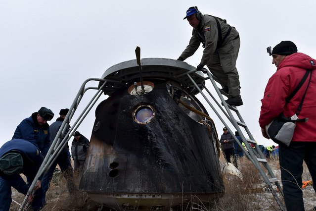 Members of a search and rescue team work at the site of landing of a Soyuz capsule carrying International Space Station (ISS) crew members U.S. astronaut Scott Kelly, Russian cosmonauts Sergei Volkov and Mikhail Korniyenko near the town of Dzhezkazgan (Zhezkazgan), Kazakhstan, March 2, 2016. (Photo by Kirill Kudryavtsev/Reuters)