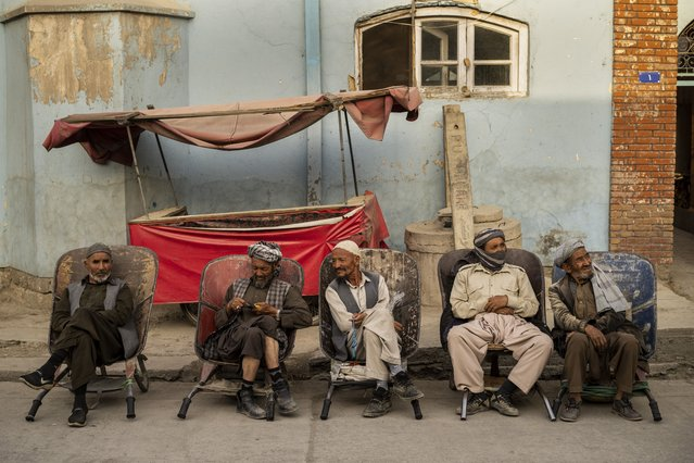 Laborers wait in the street to be hired, in Kabul, Afghanistan, Sunday, September 12, 2021. (Photo by Bernat Armangue/AP Photo)