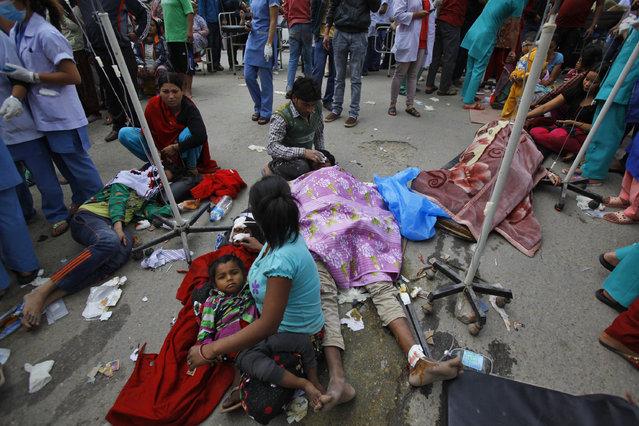 Injured people receive treatment outside Medicare Hospital in Kathmandu, Nepal, Saturday, April 25, 2015. (Photo by Niranjan Shrestha/AP Photo)