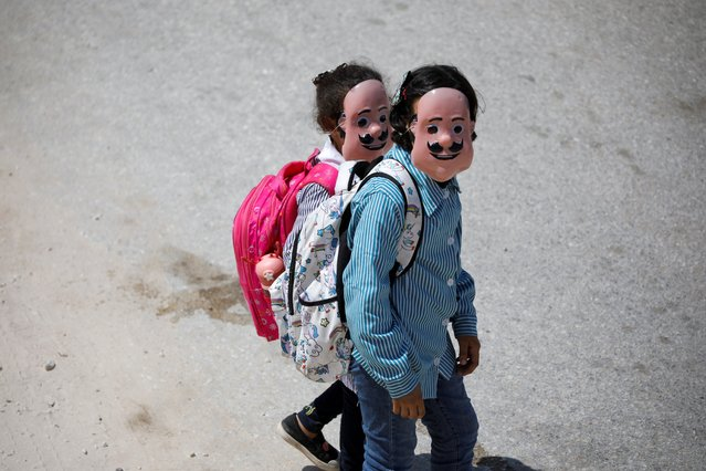 Palestinian students wearing masks return from school in Tubas, Israeli-occupied West Bank, September 5, 2021. (Photo by Raneen Sawafta/Reuters)