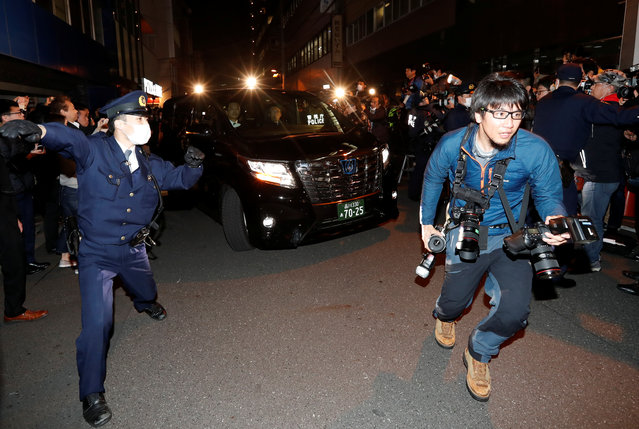 A car carrying former Nissan Motor Chairman Carlos Ghosn is surrounded by journalists as it leaves Ghosn's lawyer's office, in Tokyo, Japan, March 6, 2019. Former Nissan chief Carlos Ghosn left his Tokyo detention centre on March 6 after more than 100 days in custody, following a shock court decision granting him bail of one billion yen ($9 million). (Photo by Issei Kato/Reuters)