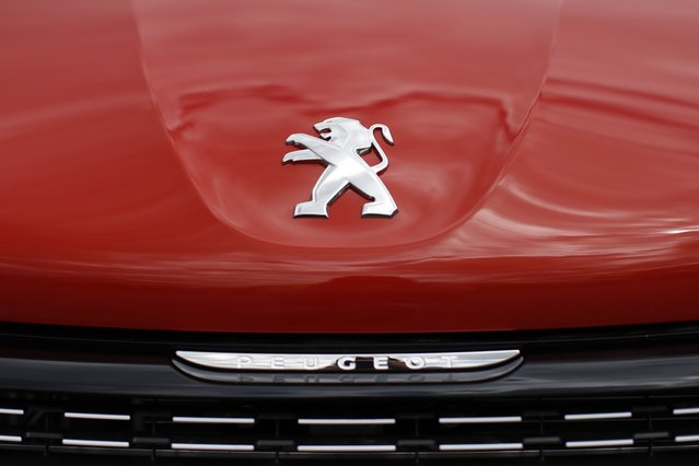 A logo is pictured on a Peugeot 208 car parked at the PSA Peugeot Citroen plant in Poissy, near Paris, France, April 29, 2015. (Photo by Benoit Tessier/Reuters)