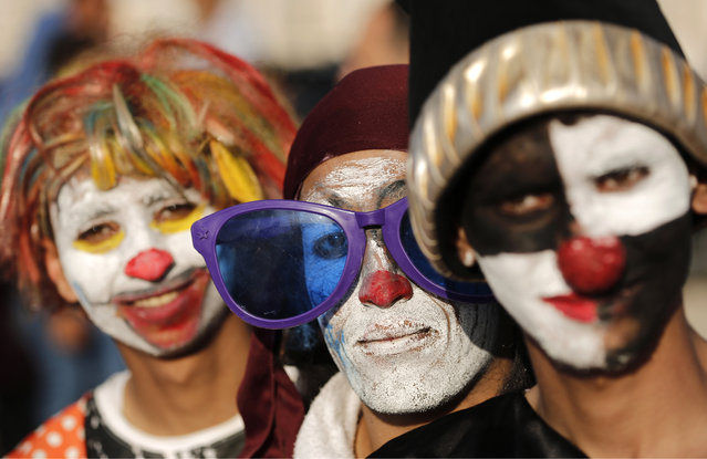 Palestinians dressed as clowns pose for a picture during an event for children organised by the Pink Panther group to mark the day of the Palestinian clown, at the seaport in Gaza City on May 1, 2015. (Photo by Mohammed Abed/AFP Photo)