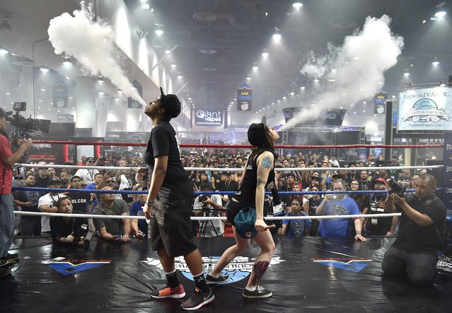 Two attendees compete in the biggest vape cloud competition at the Vape Summit 3 in Las Vegas, Nevada May 2, 2015. According to new research provided to Reuters, youngsters say that performing tricks is one of the top two reasons they began using e-cigs. (Photo by David Becker/Reuters)