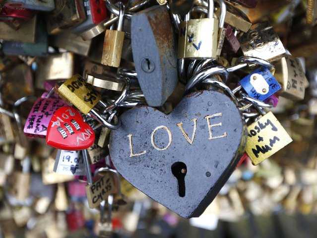 "Most of the padlocks are heat shaped or have word ""love"" written on them. (Photo by Charles Platiau/Reuters)"