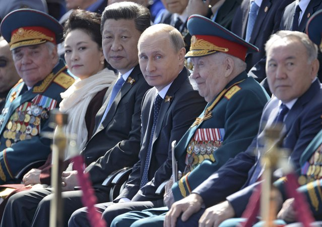 Russian President Vladimir Putin (C) and Chinese President Xi Jinping (3L) watch the Victory Day parade at Red Square in Moscow, Russia, May 9, 2015. (Photo by Reuters/Host Photo Agency/RIA Novosti)