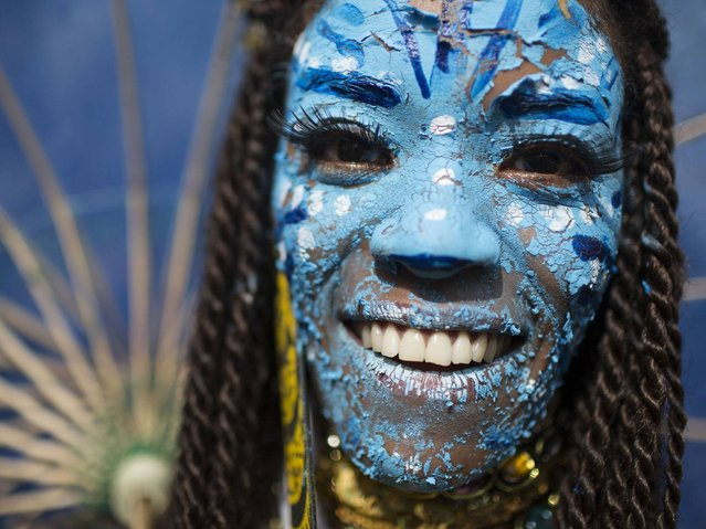 """A reveler dressed as a character from the movie Avatar poses for a photo at the """"Ceu na Terra"""" block party during Carnival celebration in Rio de Janeiro. (Photo by Felipe Dana/AP Photo)"""