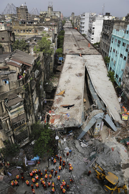 General view shows a partially collapsed overpass in Kolkata, India, Friday, April 1, 2016. (Photo by Bikas Das/AP Photo)