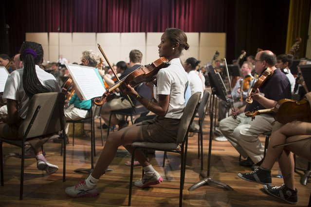 Music student Cassia Perez, (C), plays the violin during a rehearsal with the Minnesota Orchestra in Havana, May 15, 2015. (Photo by Alexandre Meneghini/Reuters)
