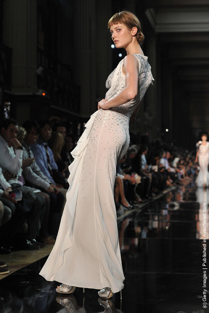 A model walks the runway during the John Galliano Ready to Wear Spring / Summer 2012 show during Paris Fashion Week