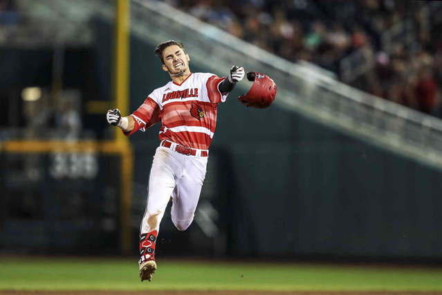Louisville's Drew Campbell celebrates after driving in the winning run against Mississippi State during an NCAA College World Series baseball game Thursday, June 20, 2019, in Omaha, Neb. (Photo by Elsie Stormberg/Omaha World-Herald via AP Photo)