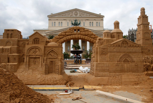 A sand sculpture is erected in front of the Bolshoi Theatre in central Moscow, Russia, April 21, 2016. (Photo by Grigory Dukor/Reuters)