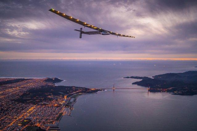 Solar Impulse 2, a solar-powered plane piloted by Bertrand Piccard of Switzerland, flies over the Golden Gate bridge in San Francisco, California, U.S. April 23, 2016, before landing on Moffett Airfield following a 62-hour flight from Hawaii. (Photo by Jean Revillard/Reuters/Solar Impulse)