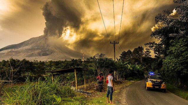 A view from Gajah Village as Mount Sinabung Eruption spewing ash volcanic to the sky, on June 09, 2019 in Karo, Indonesia. The Indonesian Geological Agency of the Ministry of Energy and Mineral Resources (KESDM) has reduced the activity level of Mount Sinabung in Karo Regency, North Sumatra. The level drops from Level IV (Caution) to Level III (Standby). Decrease in the activity level of Mount Sinabung stated by the Geological Agency (KESDM) in letter number 948/45 / BGL.V / 2019, on May 2019. (Photo by Tibta Pangin/Anadolu Agency/Getty Images)