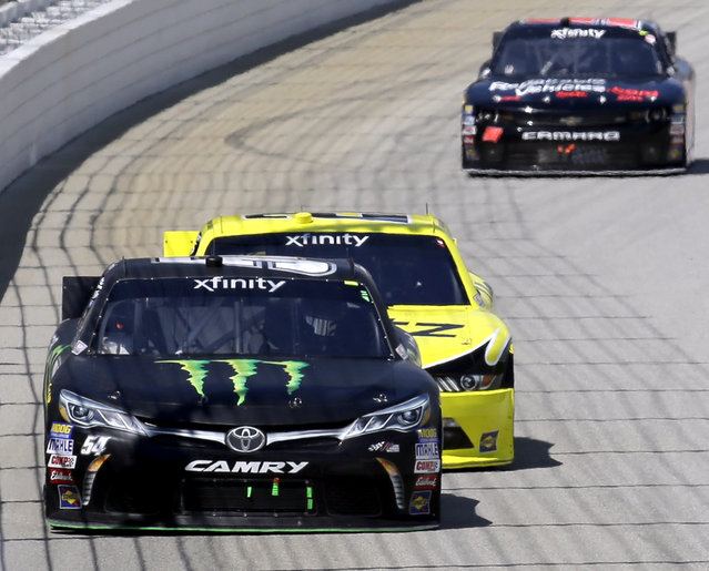 Erik Jones (54) leads during the NASCAR Xfinity series auto race at Chicagoland Speedway, Sunday, June 21, 2015, in Joliet, Ill. (AP Photo/Nam Y. Huh)