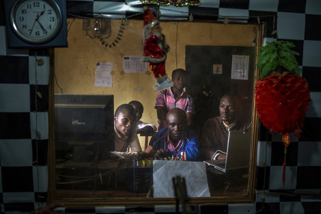In this Saturday, July 13, 2019 photo, Congolese journalists broadcast an Ebola awareness program from a local radio station in Beni, Congo. Nearly a year of public health messages have failed to reach some Congolese who fear the Ebola vaccine is just another ploy to kill people in a region wracked by violence for a quarter century. (Photo by Jerome Delay/AP Photo)