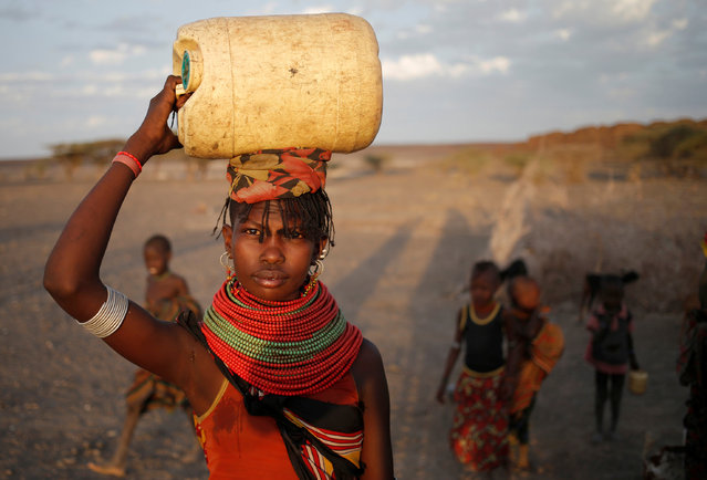 A woman carries a water canister in a village near Loiyangalani, Kenya, March 21, 2017. (Photo by Goran Tomasevic/Reuters)