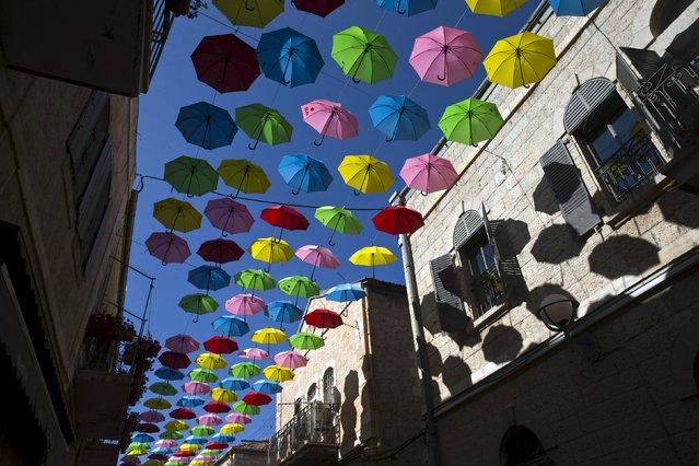 Colourful umbrellas decorate a pedestrian mall in downtown Jerusalem June 30, 2015. (Photo by Ronen Zvulun/Reuters)