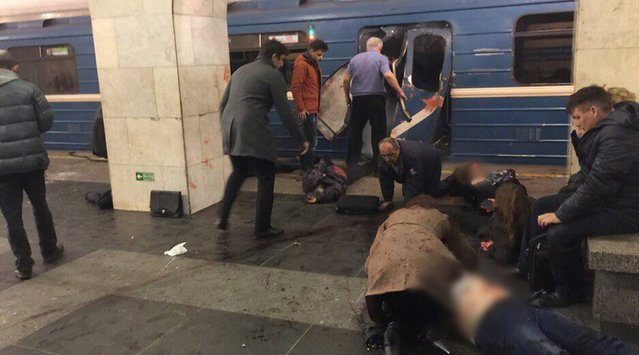 A handout photo made available by megapolisonline.ru via VKontakte (VK) shows victims shortly after an explosion in a metro of Saint Petersburg, Russia, 03 April 2017. According to reports, at least 10 people were killed and dozens injured in an explosion in the city's metro system. The cause of the blast was not immediately known. Russia's National Anti-Terrorist Committee said that the explosions hit a train between Sennaya Ploshchad and Tekhnologichesky Institut stations, media added. (Photo by EPA/Megapolisonline.ru)