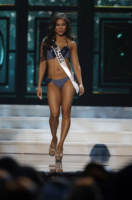 Miss Nebraska, Hoang-Kim Cung, competes in the bathing suit competition during the preliminary round of the 2015 Miss USA Pageant in Baton Rouge, La., Wednesday, July 8, 2015. (Photo by Gerald Herbert/AP Photo)