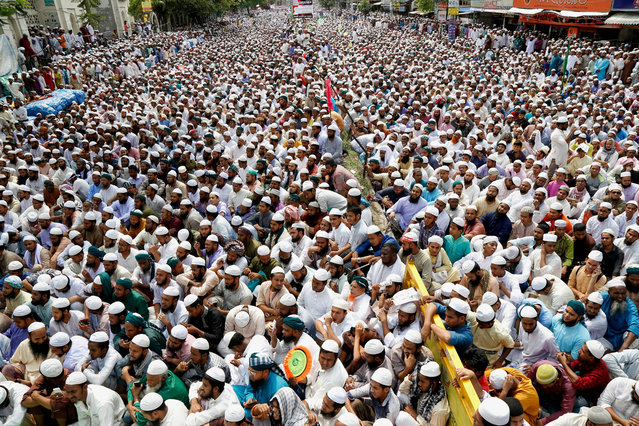 """Supporters of the """"Islami Andolan Bangladesh"""" Islamist political organization attend Friday noon prayers as they gather for a rally in front of the National Mosque at Paltan to protest against the statue of Greek Goddess from Supreme Court in Dhaka, Bangladesh, 21 April 2017. Reports state protesters are demanding the removal of a statue of the Greek goddess of justice that was placed outside the Supreme Court in December, arguing the statue goes against Islam. (Photo by  Abir Abdullah/EPA)"""