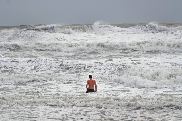 A swimmer explores big waves during high tide as Hurricane Dorian churns offshore on September 3, 2019 in Indialantic, Florida. The massive, slow-moving hurricane which devastated parts of the Bahamas with 110 mph winds and heavy rains is expected to now head northwest and travel parallel to Florida's eastern coast, according to the National Weather Service. (Photo by Scott Olson/Getty Images)