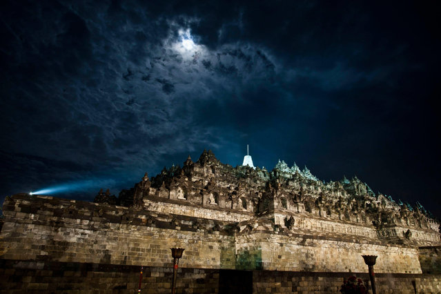 "The Borobudur temple seen illuminated during Vesak Day, commonly known as ""Buddha's birthday"", at the Borobudur Mahayana Buddhist monument on May 6, 2012 in Magelang, Indonesia. (Photo by Ulet Ifansasti/Getty Images)"