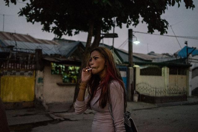Jojo smokes while heading to work. (Photo by Hannah Reyes Morales/The Washington Post)