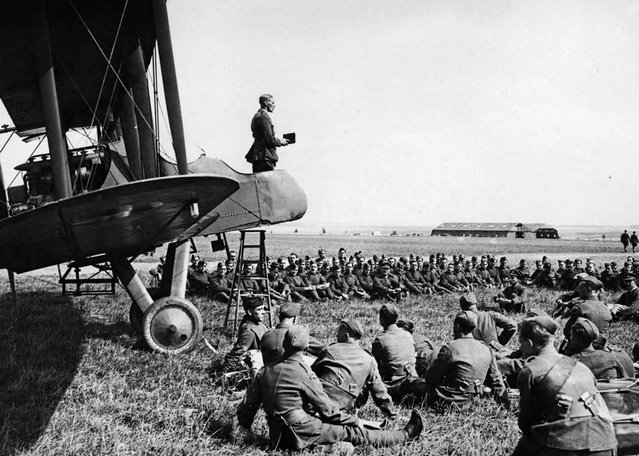 A Sunday morning service in an aerodrome in France. The Chaplain conducting the service from an aeroplane. (Photo by National Library of Scotland via The Atlantic)