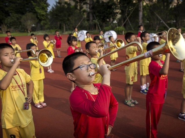 Football players take part in band practice after training at the Evergrande International Football School near Qingyuan in Guangdong Province. (Photo by Kevin Frayer/Getty Images)