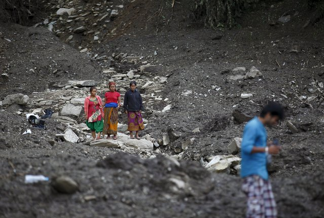 People observe the landslide-affected area after the landslide at Lumle village in Kaski district July 30, 2015. (Photo by Navesh Chitrakar/Reuters)