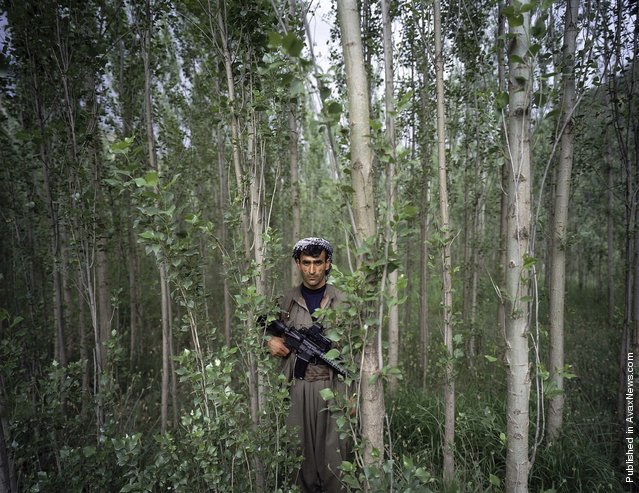 Kurdistan Workers' Party (PKK) commander Haval Syavent stands in the forest near the PKK camp of Arbur