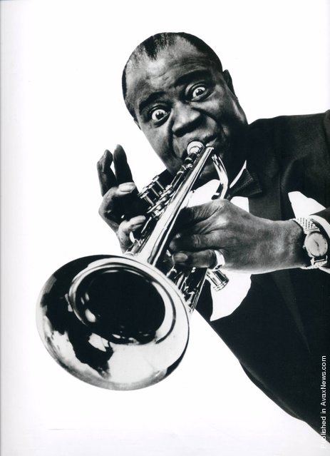 The American trumpeter, singer, composer and conductor Louis Armstrong. New York City, Halsman's studio. 15th April 1966
