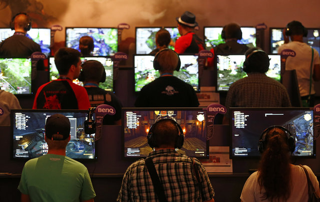 """Gamers play the """"Final Fantasy XIV: Heavensward"""" during the Gamescom 2015 fair in Cologne, Germany August 5, 2015. (Photo by Kai Pfaffenbach/Reuters)"""