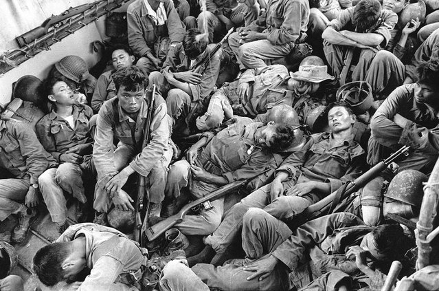 South Vietnamese government troops from the 2nd Battalion of the 36th Infantry sleep in a U.S. Navy troop carrier on their way back to the Provincial capital of Ca Mau in Aug. 1962 during the Vietnam War