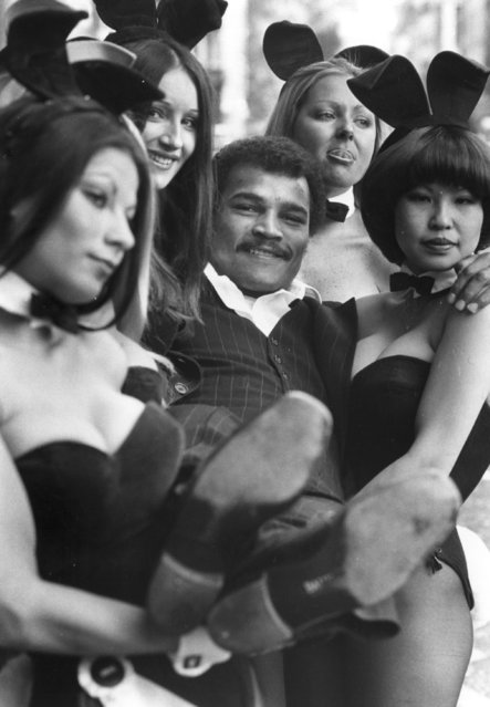 Champion British boxer John Conteh is lifted by Playboy Bunny Girls, 30th September 1974. (Photo by Monty Fresco/Evening Standard/Getty Images)