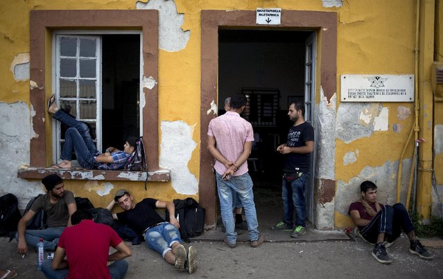 Migrants wait at Gevgelija train station in Macedonia, close to the border with Greece, August 14, 2015. (Photo by Stoyan Nenov/Reuters)
