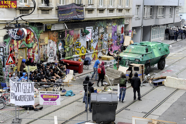 An armored police vehicle clearing the blocked street in front of a house occupied by squatters being evicted by police in Vienna, Austria,  July 28, 2014. The house in the Leopoldstadt neighborhood, has been occupied for the past two and a half years. (Photo by Herbert Oczeret/EPA)