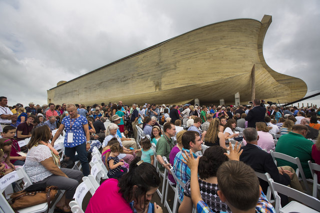 Visitors gather outside Ark Encounter, a 100 million USD, 510-foot-long re-creation of Noah's Ark in Williamstown Kentucky, USA, 05 July 2016. Ark Encounter is the brainchild of Australian-born creationist Ken Ham; it was built with the help of state tax incentives and the sale of 62 million USD in junk bonds. (Photo by Jim Lo Scalzo/EPA)