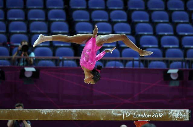 US gymnast Gabrielle Douglas takes part in a training session at 02 North Greenwich Arena in London on July 26, 2012 on the eve of the start of the London 2012 Olympic Games. (Photo by Thomas Coex/AFP)