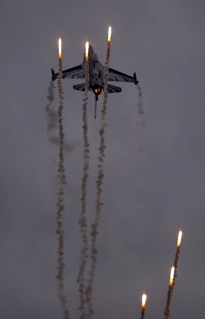 Belgium F-16 aircraft fires flares as it performs during the Radom Air Show at an airport in Radom, Poland August 23, 2015. (Photo by Kacper Pempel/Reuters)