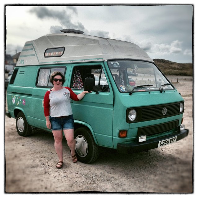 Nadine Smith, from Colchester poses for a photograph besides her 1989 third generation or T25 (T3), Volkswagen Transporter van near Newquay on August 8, 2014 in Cornwall, England. The van, which is a turbo-diesel nicknamed Frida, was bought for £6250 five years ago. (Photo by Matt Cardy/Getty Images)